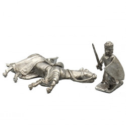 Knight kneeling near his died horse